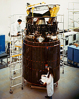 0185712 © Granger - Historical Picture ArchiveSATELLITE, c1985.   Technicians work on an HS 376 telecommunications satellite developed by Hughes Aircraft Company. Photograph, c1985.