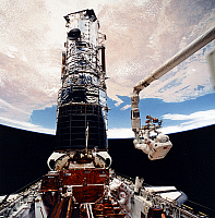 0186345 © Granger - Historical Picture ArchiveHUBBLE TELESCOPE, 1993.   American astronaut F. Story Musgrave (top) and Jeffrey Hoffman (bottom) servicing the Hubble Space Telescope during the STS-61 mission of the Space Shuttle Endeavour, December 1993.