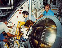 0185118 © Granger - Historical Picture ArchiveSPACE SHUTTLE CHALLENGER.   NASA mechanics installing a Ku-band antenna in the cargo bay of the Space Shuttle Challenger, before its first flight, STS-6, at Kennedy Space Center in Florida. Photograph, late 1982.
