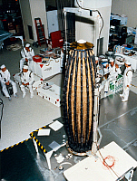 0186280 © Granger - Historical Picture ArchiveSPACE: GALILEO, 1989.   Technicians discuss procedures for lifting the S-band/X-band high gain antenna (foreground) onto the Galileo spacecraft, at the Kennedy Space Centers' Spacecraft and Assembly Encapsulation Facility 2. Photograph, 31 July 1989.