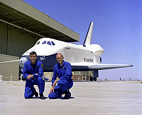 0266945 © Granger - Historical Picture ArchiveSPACE SHUTTLE ENTERPRISE.   American astronauts Fred Haise and C. Gordon Fullerton with the Space Shuttle Enterprise at the Rockwell International Space Division's Orbiter Assembly Facility in Palmdale, California. Photograph, 17 September 1976.