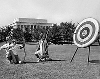 0122333 © Granger - Historical Picture ArchiveWASHINGTON, D.C.: ARCHERY.   An American family practicing archery. Photograph, 1929.