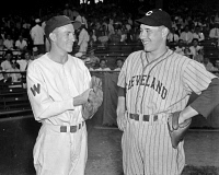0526767 © Granger - Historical Picture ArchiveBASEBALL, 1937.   Bucky Jacobs of the Washington Senators and Bob Feller of the Cleveland Indians in Washington D.C. Photograph, 2 August 1937.