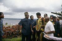 0167451 © Granger - Historical Picture ArchiveFOREMAN AND MOBUTU, 1974.   American heavyweight boxer George Foreman (center) meeting with President Mobutu Sese Seko (in leopard-skin hat) and an interpreter near the shore of the Congo River at Kinshasa, Zaire, September 1974, prior to his title defense against Muhammad Ali.