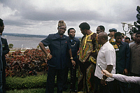 0167452 © Granger - Historical Picture ArchiveFOREMAN AND MOBUTU, 1974.   American heavyweight boxer George Foreman (center) meeting with President Mobutu Sese Seko (in leopard-skin hat) and an interpreter near the shore of the Congo River at Kinshasa, Zaire, September 1974, prior to his title defense against Muhammad Ali.
