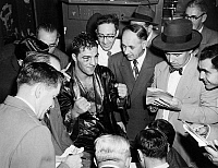 0170314 © Granger - Historical Picture ArchiveROCKY MARCIANO (1924-1969).   American boxer. Marciano talking with reporters after his victory against Joe Louis at Madison Square Garden in New York City, 26 October 1951.