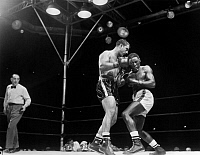 0170316 © Granger - Historical Picture ArchiveMARCIANO & CHARLES, 1954.   Rocky Marciano (left) defending his heavyweight title in a fight against Ezzard Charles at Yankee Stadium in the Bronx, New York City, 17 June 1954.