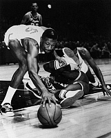 0170593 © Granger - Historical Picture ArchiveBILL RUSSELL (1934- ).   American basketball player. Russell, playing for the Boston Celtics, reaching for a free ball rolling away from his teammate Sam Jones and Leroy Ellis of the L.A. Lakers during a game at Madison Square Garden in New York City, November 1963.
