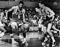 0170594 © Granger - Historical Picture ArchiveBILL RUSSELL (1934- ).   American basketball player. Russell (left) with the Boston Celtics, with John Havlicek at right playing a game against the Los Angeles Lakers at Madison Square Garden in New York City, 1967. Jim Barnes of the Lakers is at far left.