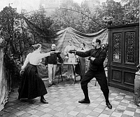0130948 © Granger - Historical Picture ArchiveFENCING, c1904.   A woman and a man dueling as three people watch. Photograph, c1904.