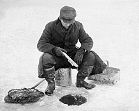 0113688 © Granger - Historical Picture ArchiveICE FISHING, c1910-1915.   Man fishing through ice using a stick and string. Photograph, c1910-1915.