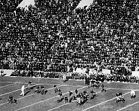 0170363 © Granger - Historical Picture ArchiveCOLLEGE FOOTBALL GAME, 1921.   A view of the action during a football game between Harvard and Princeton, at Palmer Stadium, Princeton, New Jersey, 5 November 1921.