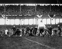0170377 © Granger - Historical Picture ArchiveFOOTBALL GAME, 1925.   An unidentified player for the Chicago Bears attempting to gain yards in a game against the New York Giants, at the Polo Grounds in New York City, 6 December 1925.