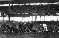 0170378 © Granger - Historical Picture ArchiveFOOTBALL GAME, 1925.   Phil White of the New York Giants attempting to gain yards in a game against the Chicago Bears, at the Polo Grounds in New York City, 6 December 1925.