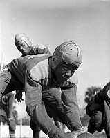 0264961 © Granger - Historical Picture ArchiveFOOTBALL TEAM, 1943.   A football player from Bethune-Cookman College in Daytona Beach, Florida. Photograph by Gordon Parks, 1943.