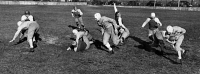 0527575 © Granger - Historical Picture ArchiveHIGH SCHOOL FOOTBALL, 1941.   High school football players running plays in Cleveland, Ohio. Photograph by William Greene, 1941.