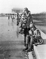 0118913 © Granger - Historical Picture ArchiveICE SKATERS.   Two women identified as Celene DuPuy and Abbey Jackson (seated) wearing ice skates, posing at the Reflecting Pool, with the Lincoln Memorial in the background, Washington, D.C. Photograph, early 20th century.