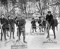 0118915 © Granger - Historical Picture ArchiveICE SKATING.   A group of boys clean the snow off of the ice in order to skate in Washington, D.C. Photograph, c1915.