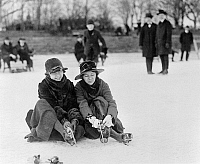 0118916 © Granger - Historical Picture ArchiveICE SKATING, c1915.   Two women seated on the snow putting on their ice skates, in the Washington, D.C. area. Photograph, c1915.
