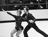 0171872 © Granger - Historical Picture ArchiveICE DANCERS, 1975.   American ice dancing couple Colleen O'Connor and Jim Millns performing at the U.S. Figure Skating Championships in Oakland, California, where they repeated as champions, January 1975.