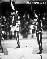 0046707 © Granger - Historical Picture ArchiveOLYMPIC GAMES, 1968.   American runners Tommie Smith (left) and John Carlos (right) giving the Black Power salute during the medal ceremonies at the Summer Olympic Games in Mexico City. Photograph, 1968.