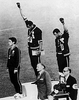 0130918 © Granger - Historical Picture ArchiveOLYMPIC GAMES, 1968.   American runners Tommie Smith (center) and John Carlos (right) showing the Black Power salute during the medal ceremonies at the Olympic Games in Mexico City. Australian Peter Norman (left) wears an OPHR badge in solidarity. Photograph, 1968.