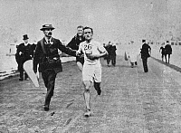 0175000 © Granger - Historical Picture ArchiveJOHNNY HAYES (1886-1965).   American athlete. Photographed while running the marathon at the 1908 Olympic Games.