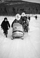 0176557 © Granger - Historical Picture ArchiveALASKA: SNOWMOBILE.   Children riding snowmobiles in Elim, Alaska. Photograph, late 20th century.