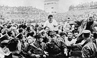 0131249 © Granger - Historical Picture ArchiveFRITZ WALTER (1920-2002).   Captain of the West German soccer team, lifted by a crowd of revelers after the West German victory against Hungary in the 1954 World Cup held in Switzerland.