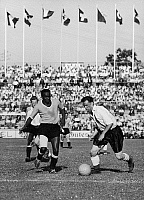 0131251 © Granger - Historical Picture ArchiveWORLD CUP, 1954.   Victor Rodriguez Andrade of Uruguay (left) and Nathaniel Lofthouse of England face off during the 1954 World Cup in Switzerland.