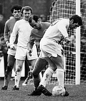 0131258 © Granger - Historical Picture ArchiveSOCCER MATCH, c1970.   Soccer match between Leeds United and Sutton United, c1970. Johnny Giles of Leeds (with ball) is watched by Billy Bremner and two Sutton players.