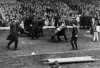 0131286 © Granger - Historical Picture ArchiveSCOTTISH CUP, 1969.   Police scuffle with unruly fans at the game between the Celtics and the Rangers during the Scottish Cup soccer competition, 26 April 1969.