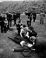 0131287 © Granger - Historical Picture ArchiveINJURED SOCCER FANS, 1969.   Paramedics attending to young soccer fans injured in a mob after the Celtics victory over the Rangers in the Scottish Cup, 26 April 1969.
