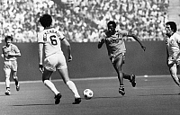 0131288 © Granger - Historical Picture ArchiveSOCCER MATCH, c1977.   Soccer match between the L.A. Aztecs and the New York Cosmos, c1977. Steve David (right) advances toward Franz Beckenbauer.