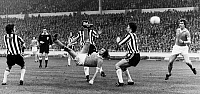 0131290 © Granger - Historical Picture ArchiveSOCCER MATCH, 1976.   Dennis Tueart of Manchester City scores the winning goal against Newcastle United with an overhead kick, 1976.