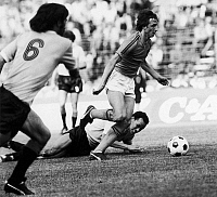 0131302 © Granger - Historical Picture ArchiveJOHAN CRUYFF (1947- ).   Dutch soccer player. Cruyff runs through Uruguay's defense during the 1974 World Cup, held in West Germany.