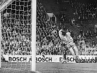 0131304 © Granger - Historical Picture ArchiveWORLD CUP, 1966.   Uruguayan goalkeeper Ladislao Mazurkiewicz misses a ball shot by Uwe Seeler of West Germany during the 1966 World Cup, held in England.