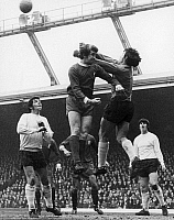 0131438 © Granger - Historical Picture ArchiveENGLAND: SOCCER GAME, 1970.  Gordan Banks, the goalkeeper for Stoke City FC punches the ball away from Chris Lawler of Liverpool during a game, 26 December 1970.