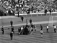 0131443 © Granger - Historical Picture ArchiveWORLD CUP, 1966.   Police officers rush on to the field at Wembley Stadium to protect Referee Rudolf Kreitlin after the final whistle during the World Cup quarter final match between England and Argentina, 23 July 1966.