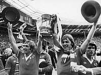 0131448 © Granger - Historical Picture ArchiveENGLAND: FA CUP, 1977.   Jimmy Greenhoff (left) and Brian Greenhoff of Manchester United celebrate their victory over Liverpool F.C. in the FA Cup final, 21 May 1977.