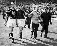 0131451 © Granger - Historical Picture ArchiveBERT TRAUTMANN (1923- ).   German-born English soccer player for Manchester City. Trautmann (center left), having played the last minutes of the game with a neck injury, leaving the field after Manchester's victory over Birmingham City in the FA Cup Final, 1956.