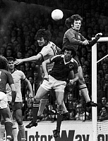 0131454 © Granger - Historical Picture ArchiveENGLAND: SOCCER MATCH, 1977.   Pat Jennings of Arsenal FC jumps above his own defense player (left) to block a goal by Bristol City, 22 October 1977.