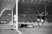 0131462 © Granger - Historical Picture ArchiveEUROPEAN CUP, 1965.   Alan Sealey and Martin Peters of West Ham United cheer after Sealey's goal against Munich during the European Cup Final match at Wembley Stadium, London, 19 May 1965.