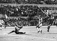 0131476 © Granger - Historical Picture ArchiveSOCCER: EUROPEAN CUP, 1977.   Terry McDermott (right) scores the first goal for Liverpool FC against goalie Wolfgang Kleff and Berti Vogts (center) of Borussia Moenchengladbach FC during the European Cup Final match, 25 May 1977.