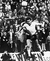 0131501 © Granger - Historical Picture ArchiveENGLAND: SOCCER MATCH.   Jim Giles (left) of Charleston FC and Ian Porterfield of Sunderland FC jump for the ball during a soccer match, 15 November 1975.