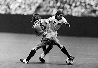 0131520 © Granger - Historical Picture ArchiveSTEPHEN HUNT (1956- ).   English soccer player. Hunt (right) playing for the New York Cosmos, battles Bernie Fagan of the Los Angeles Aztecs during a match, c1977.