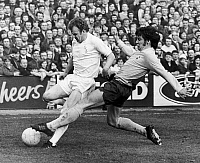 0131558 © Granger - Historical Picture ArchiveENGLAND: SOCCER MATCH, 1972.   Soccer match between Leeds United and Tottenham Hotpur during the FA Cup, 18 March 1972. Leeds captain Billy Bremner is tackled by Cyril Knowles.