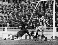 0131701 © Granger - Historical Picture ArchiveENGLAND: SOCCER MATCH, 1973.   Soccer match between Chelsea FC and Stoke City FC. Peter Bonetti of Chelsea blocks a goal shot by Terry Conroy, 7 April 1973.