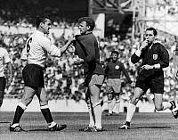 0131702 © Granger - Historical Picture ArchiveENGLAND: SOCCER MATCH, 1966.   Dave McKay (left) of Tottenham Hotspur confronts Billy Bremner of Leeds United during a game, 22 August 1966. Referee Norman Burtenshaw blows his whistle to intervene.