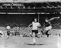 0131709 © Granger - Historical Picture ArchiveWORLD CUP, 1966.   Geoff Hurst of West Germany (right) scores his third goal against England during the 1966 World Cup final match.